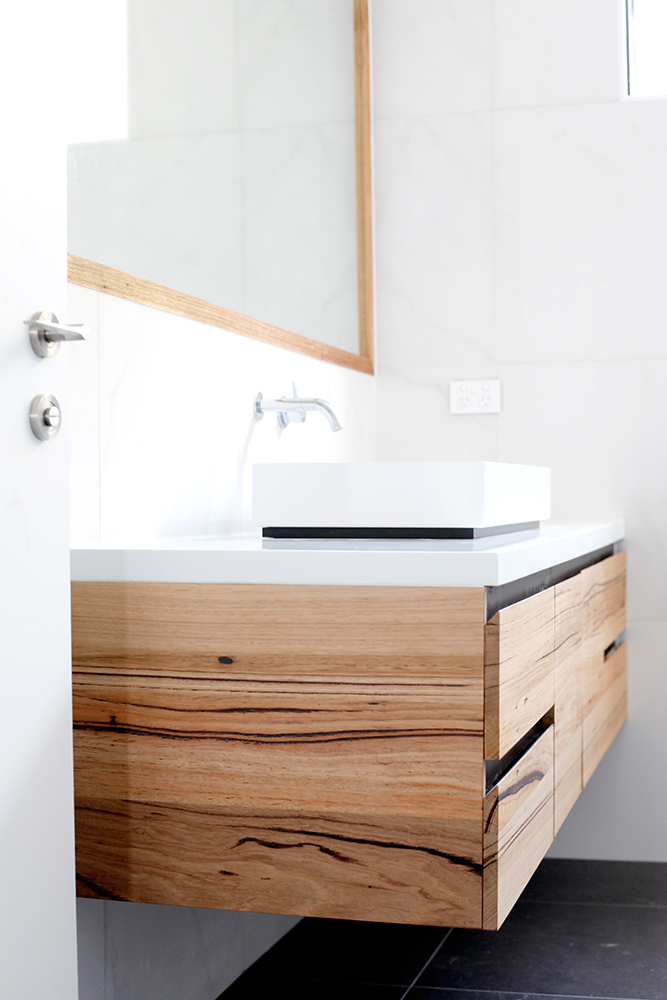 floating timber vanity with stone top