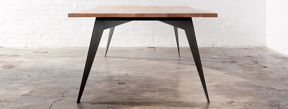 industrial dining table with refined metal legs
