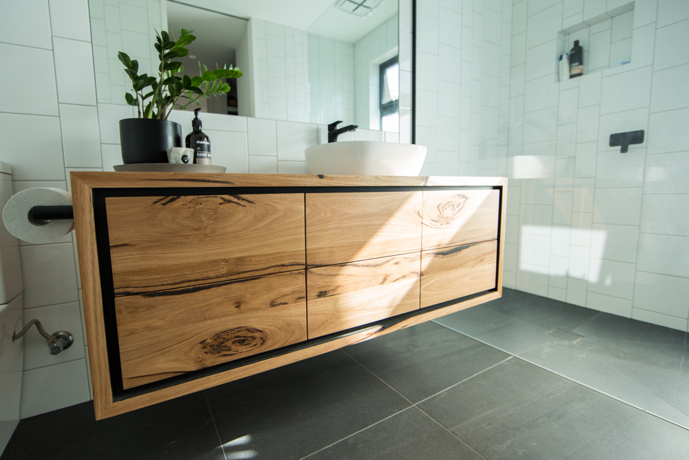 Wall hung wooden vanity with drawers