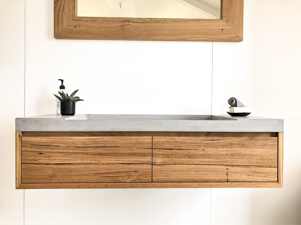 Floating timber vanity with concrete basin