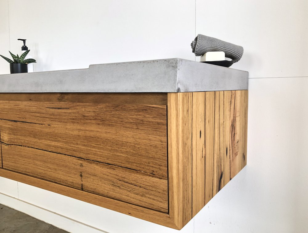 timber vanity with integrated concrete basin