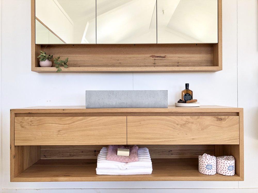 Wall hung timber vanities with shelf