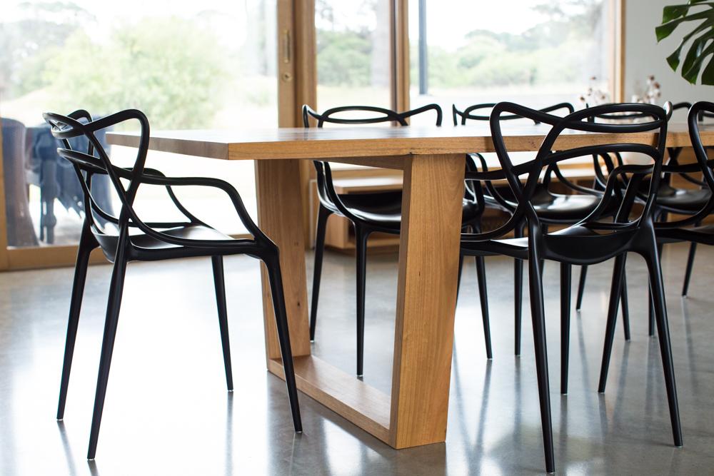 Angled box leg dining table