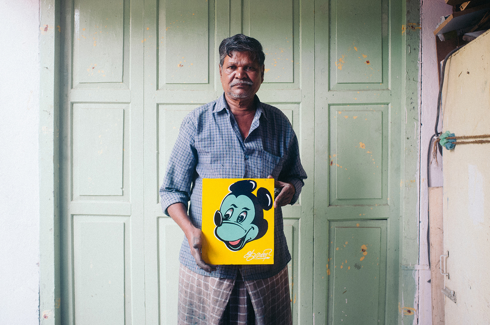 Mani, the auto painter of Madurai, with one of his Mickeys.