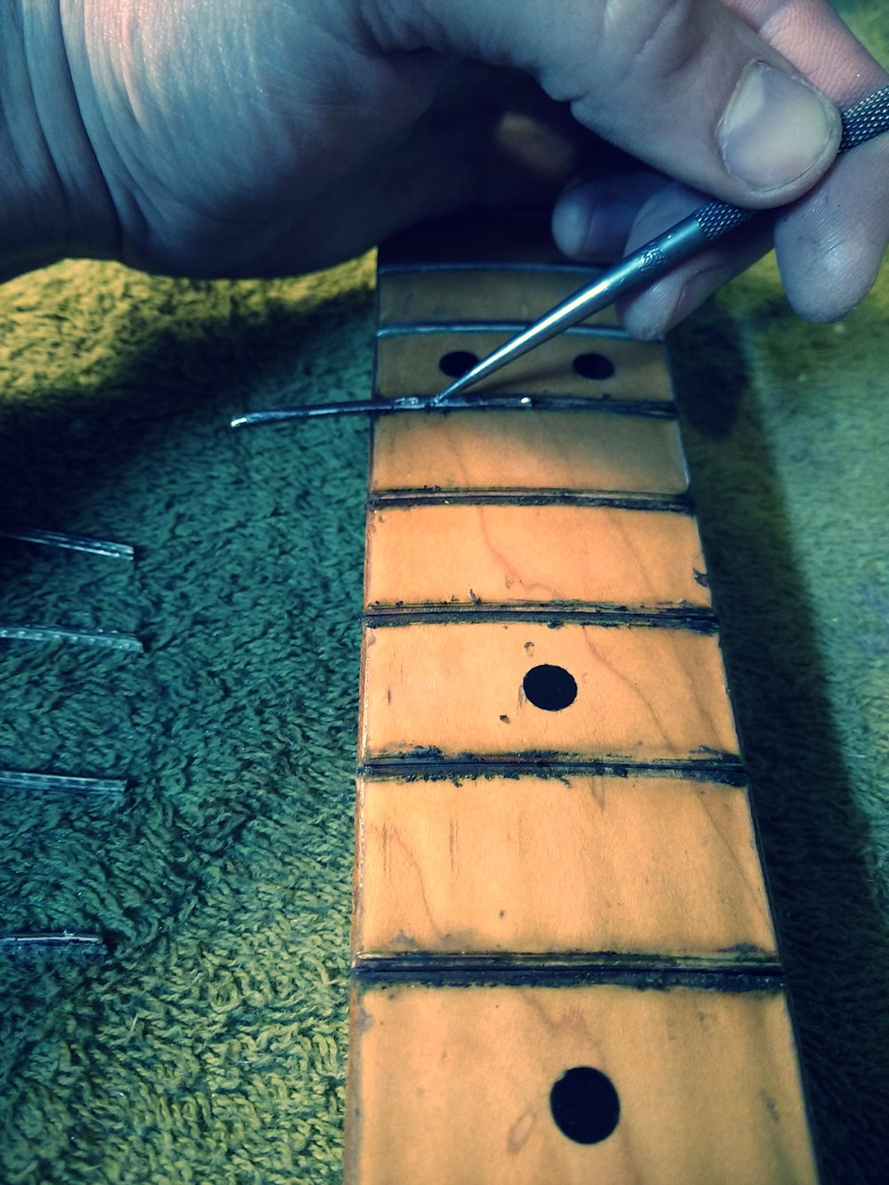 The original worn down Fender frets go out SIDEWAYS