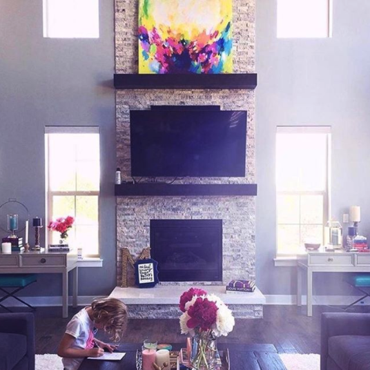 "A chic mom decided to order a stretched canvas of  ""Rebirth""  to be the center statement piece above her fireplace. My collectors often report back that they can't believe how much more vibrant and colorful the work is in person!"