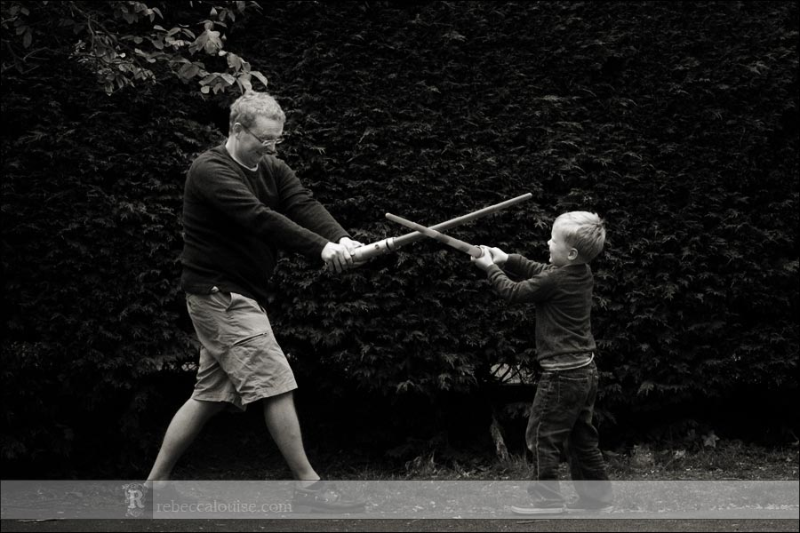 Wimbledon family portraits - sword fighting