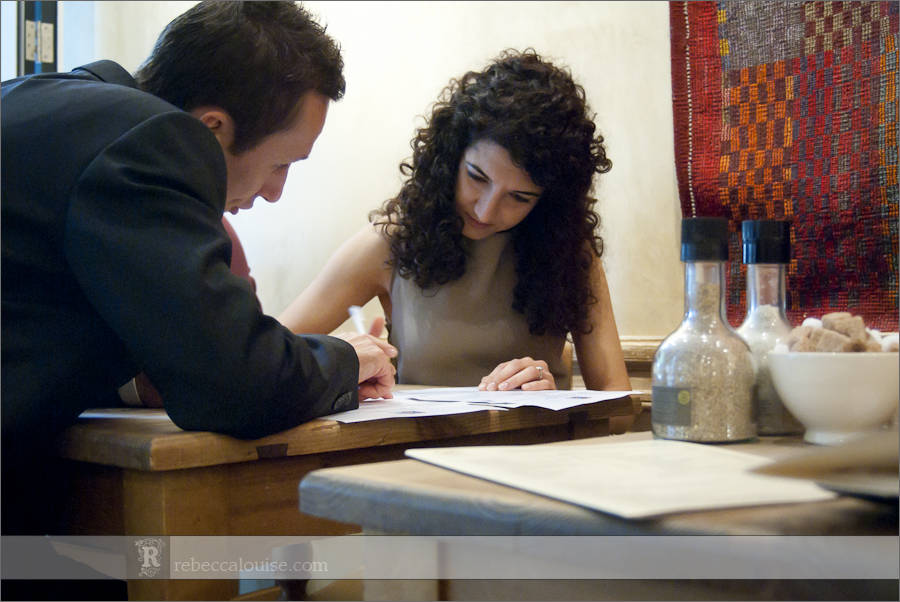 bride and groom checking paperwork