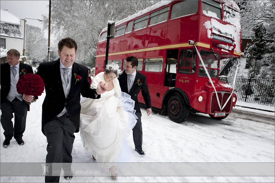 Greenwich wedding in snow with routemaster bus