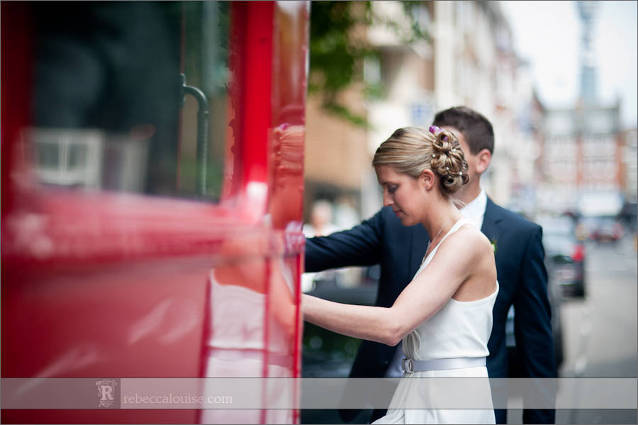 Bride and groom get on board red Routemaster bus near Westminster, London