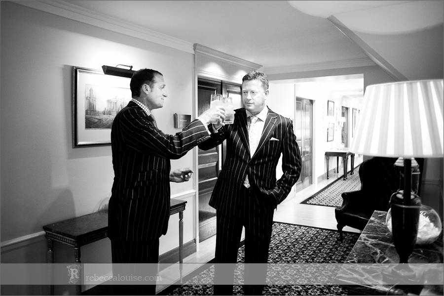 Groom and best man at Claridge's have a drink before wedding ceremony