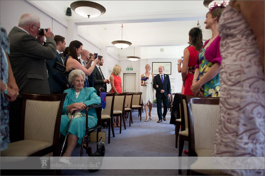Bride and father arrive for civil wedding ceremony at Westminster Register Office's purple room