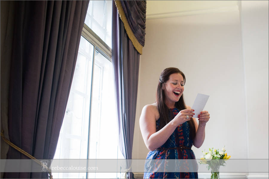 Guest does a wedding reading in Purple Room, Westminster