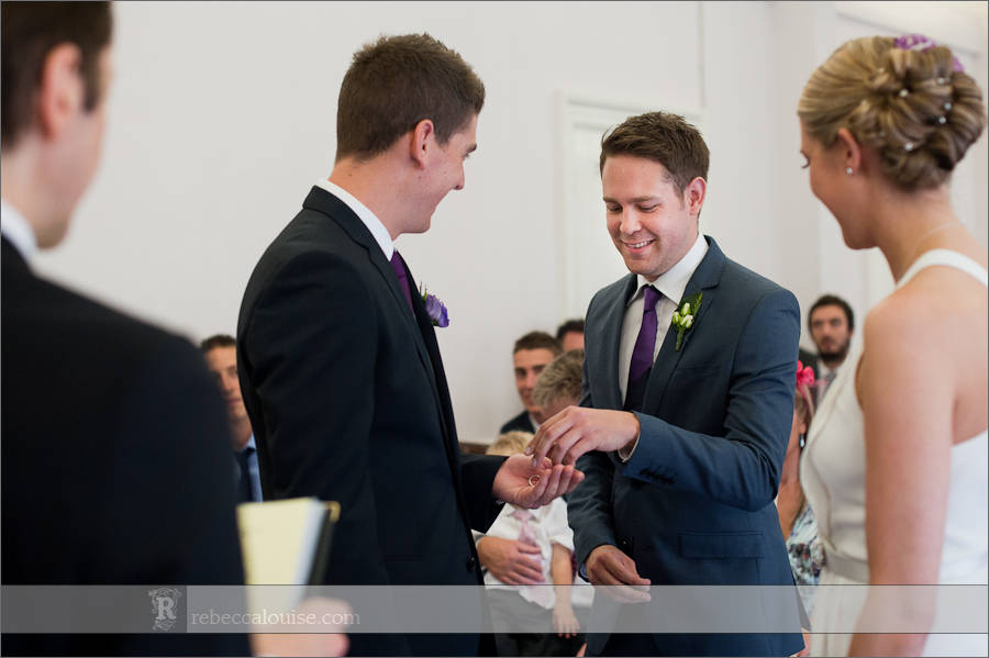 Best man hands over ring to groom in Westminster wedding ceremony