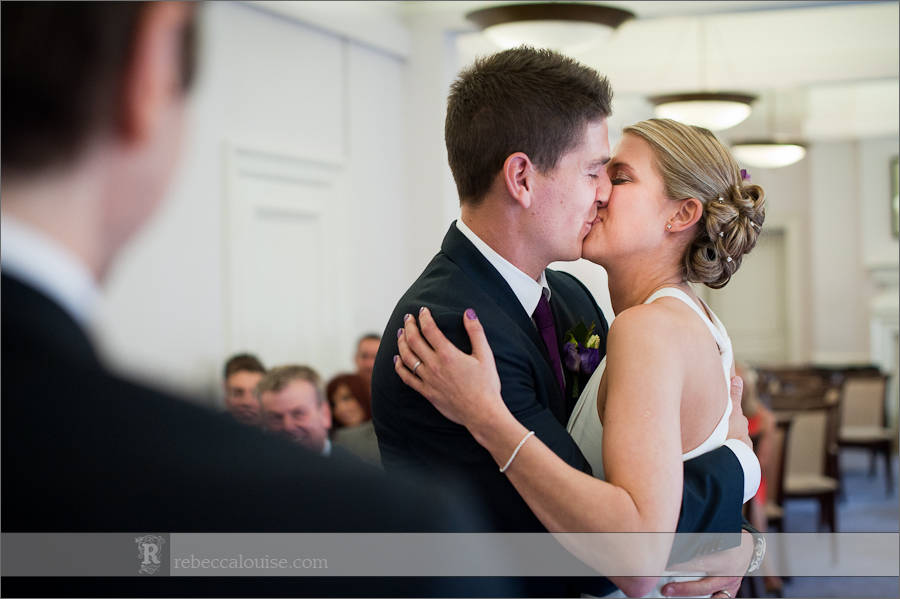 Bride and groom kiss after married at Westminster