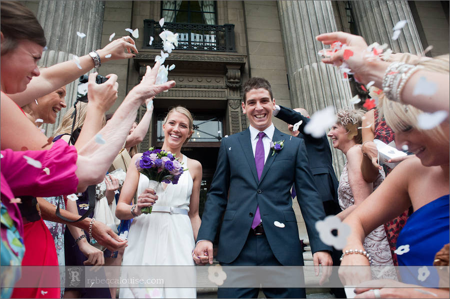 Bride and groom and confetti on steps of Westminster Register Office, Old Marylebone Town Hall