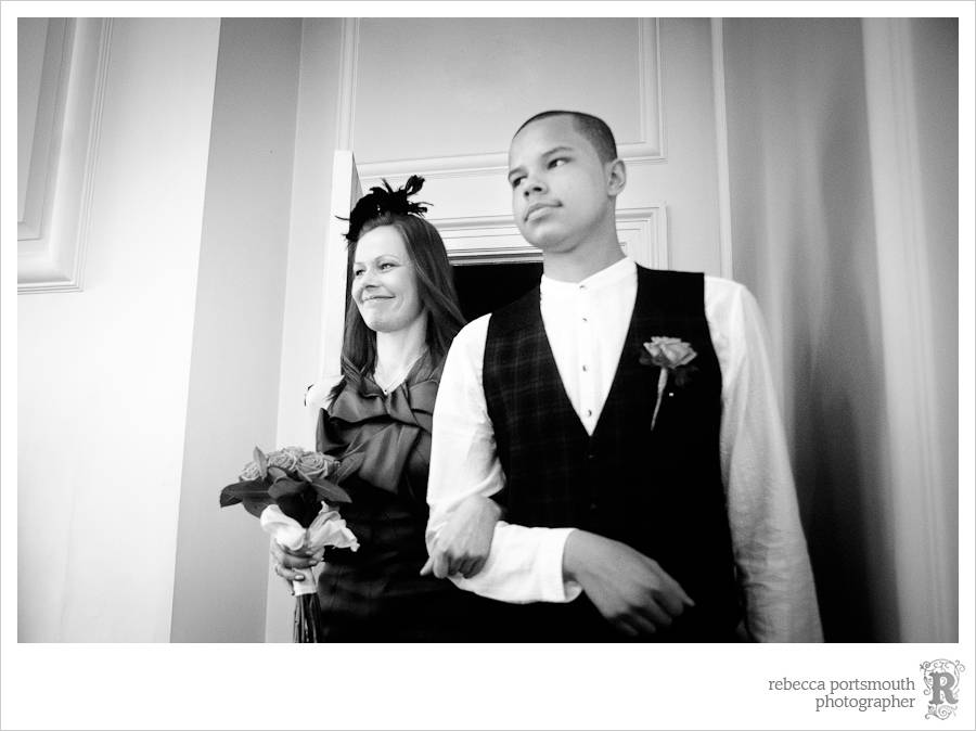 The bride Lynsey and her son enter the Blue Room at Old Marylebone Town Hall.