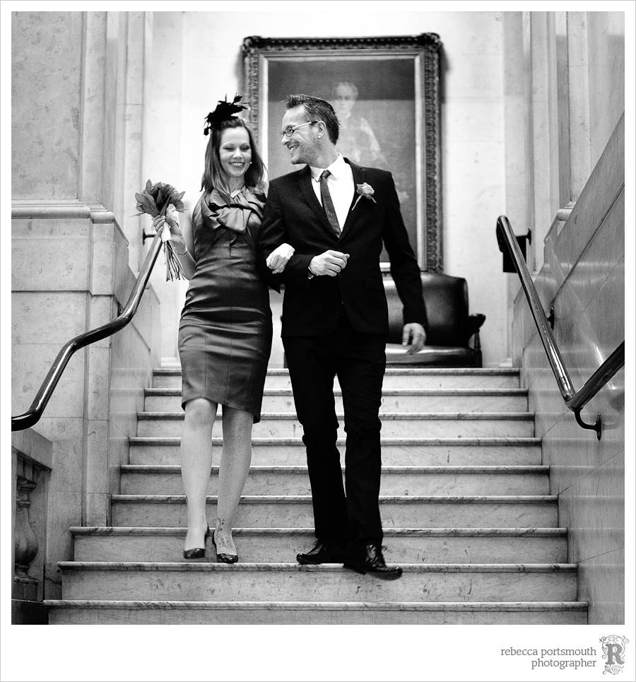 Lynsey and Matt walk down the Westminster Register Office stairs after their ceremony.