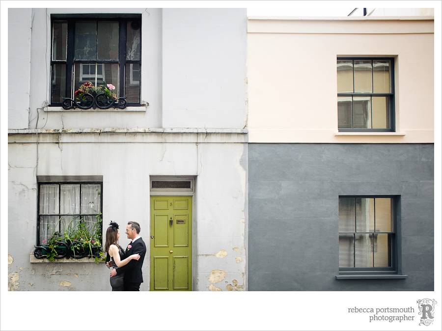 Bride and groom portraits with vintage green door and house