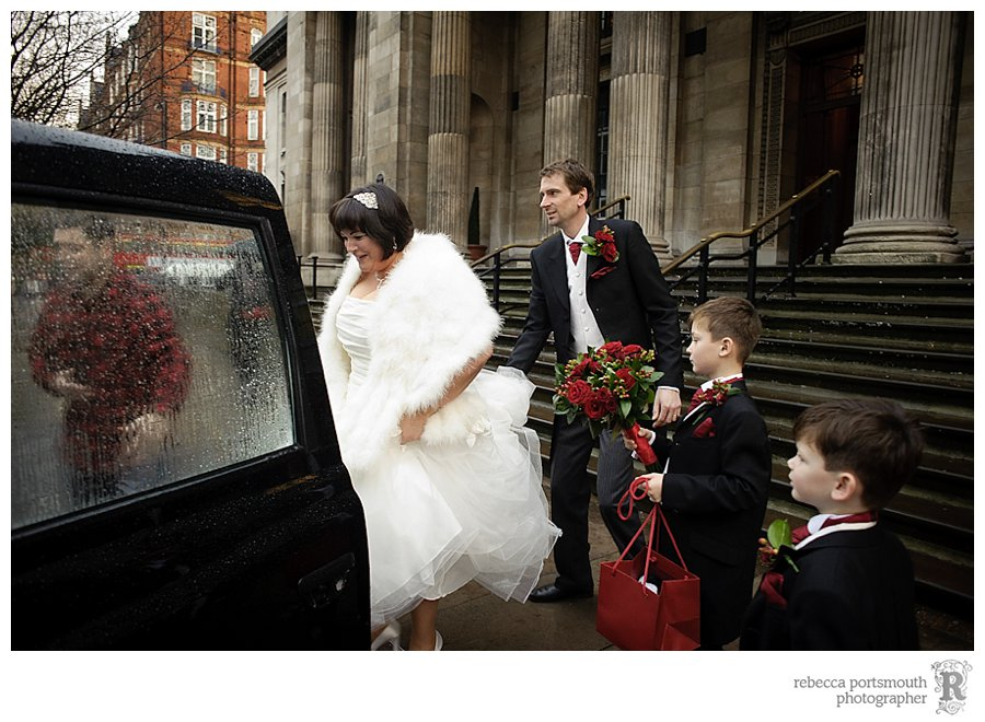 Karen, Matthew and their family leave Westminster Register Office wedding ceremony  in a London black cab.