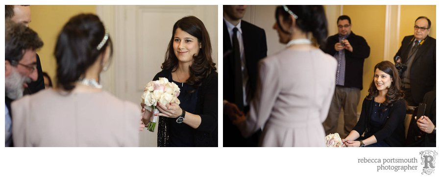 Emine's best woman taking her bouquet during her civil wedding ceremony.