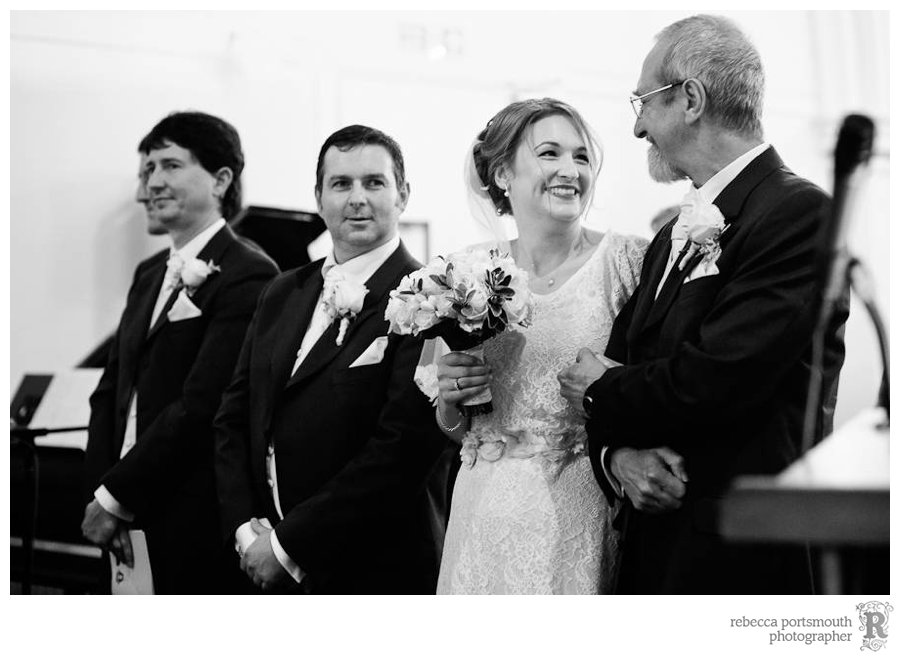 Bride says goodbye to father at wedding ceremony at St Andrew's Thornhill Square, London N1 Islington
