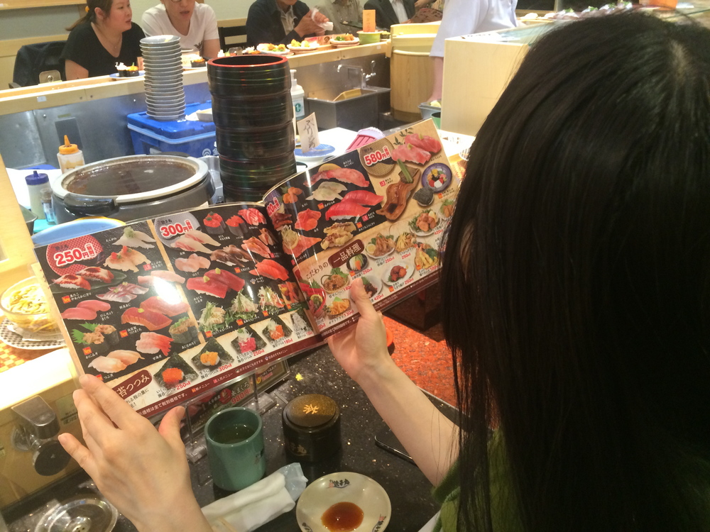 Reiko ordering the food for me..i think we ordered everything in the menu