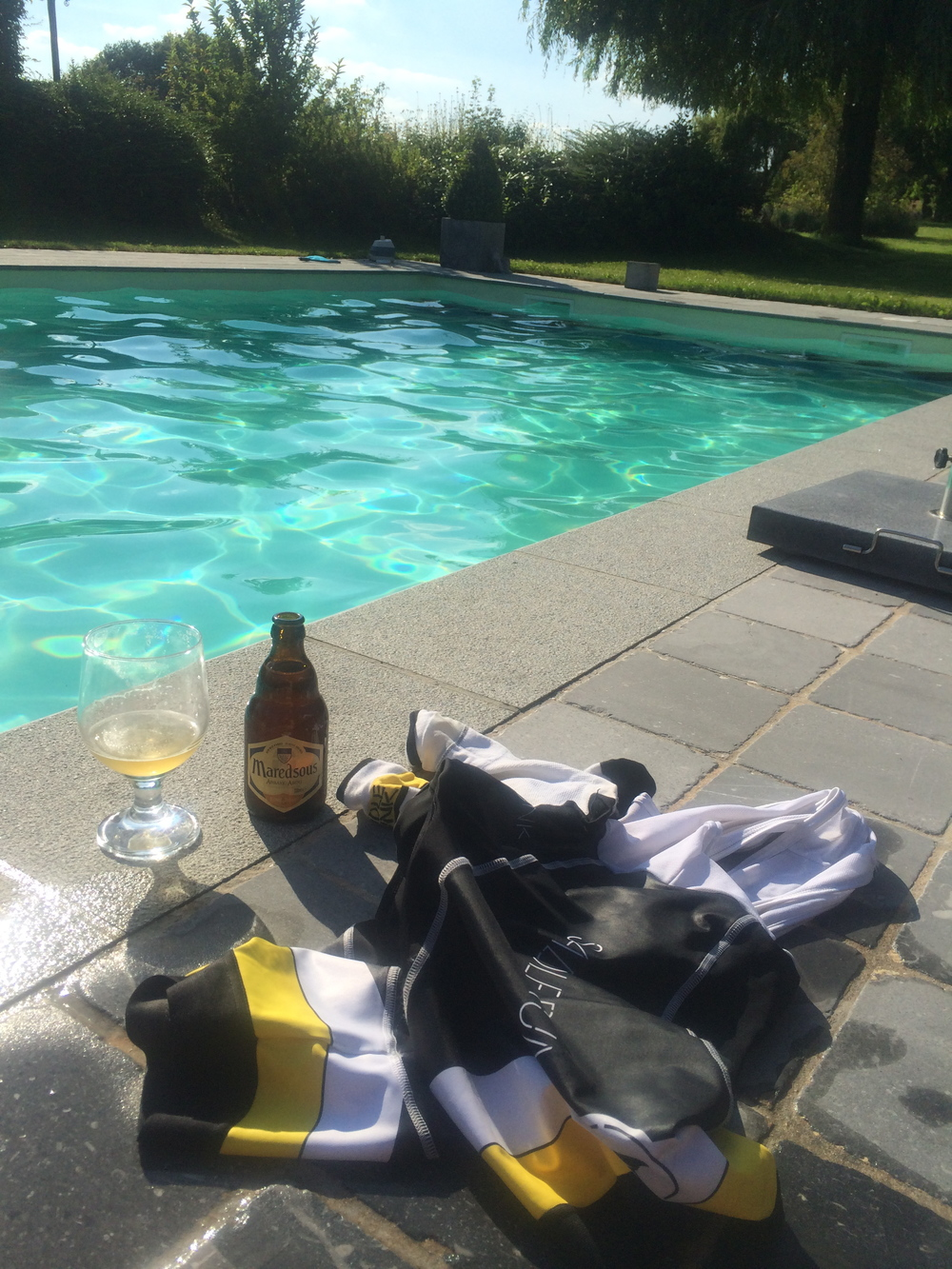 Having a belgian beer after the race by the pool