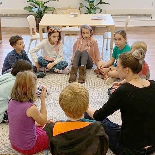 Elementary Children in group on floor.jpg