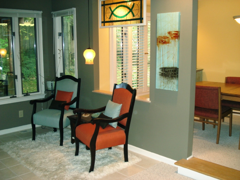 Shown hanging in a sitting area with chairs and pillows selected to match the colors of the painting.