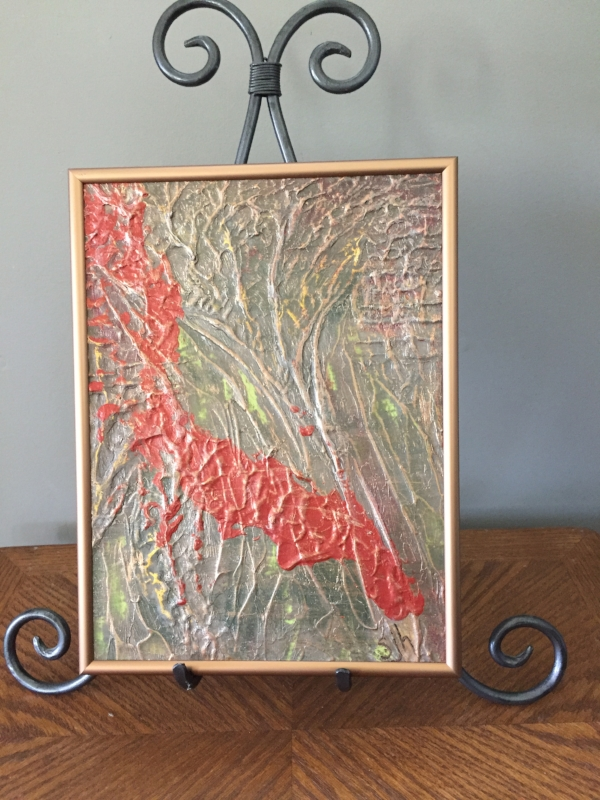 Shown on table easel.