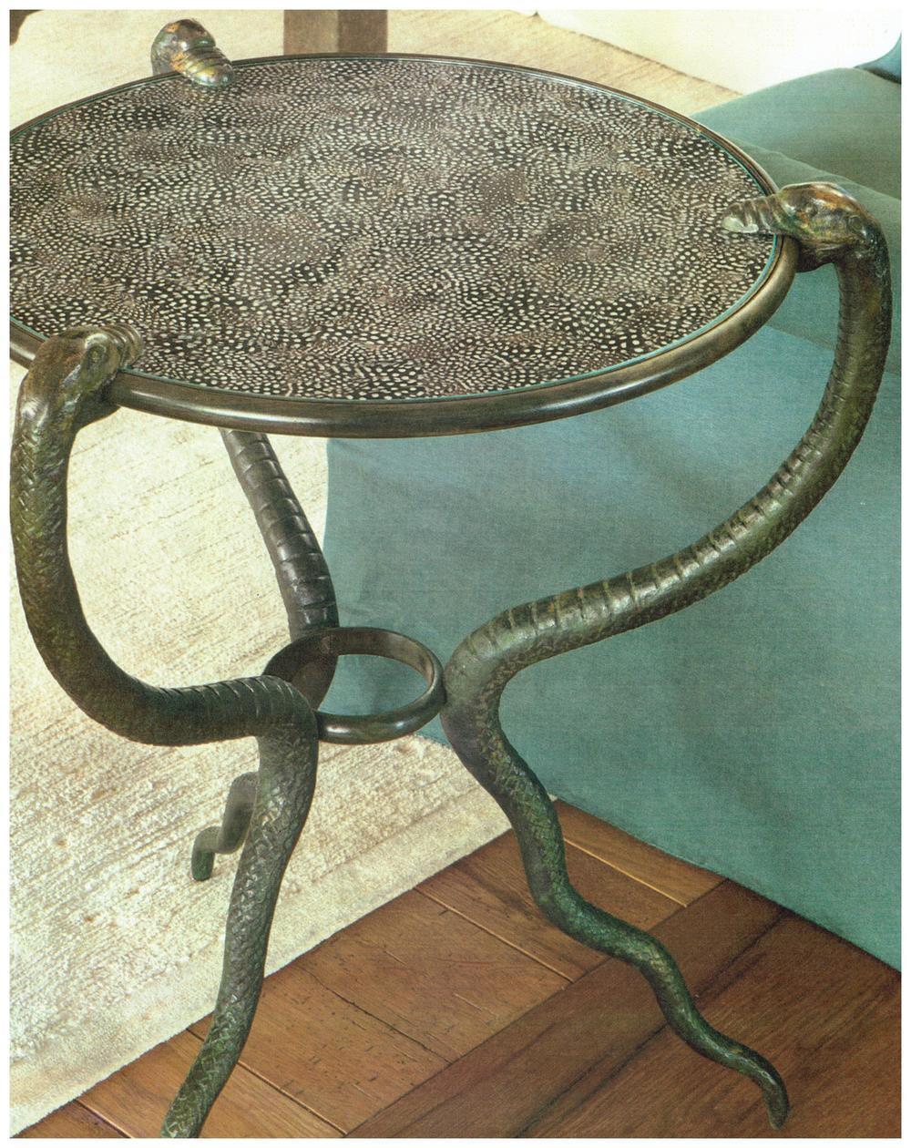 Rose Tarlow snake side table with guinea fowl feathers under glass top.