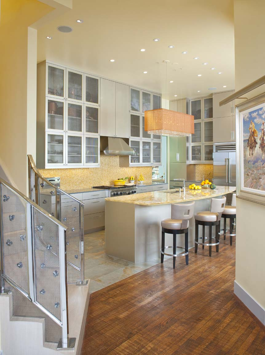A combination of under counter, strategically placed recess & decorative lighting render an award winning kitchen design.