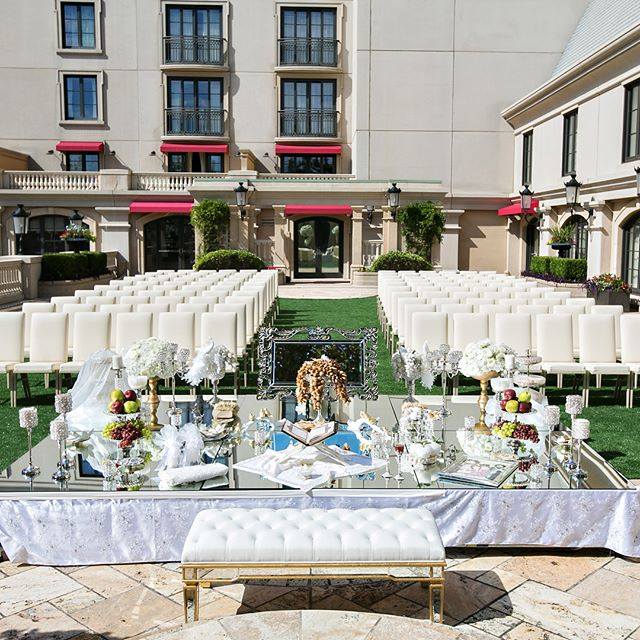 A mirror top sofreh along with amazing floral and perfect weather! #sofreh #persianwedding #persianceremony #ceremonydecor #eventdecor #outdoorwedding #mirrorfinish #atlantaevents #uniqueevents #uniqueeventelements