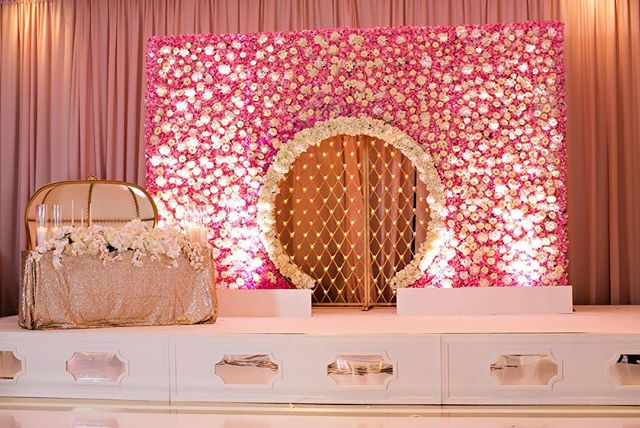 Our blush drape was the backdrop to this amazing flower wall by @akeemclayton  we dressed the stage in white carpet and provided our stage surround with mirror inserts. #stagedecor #eventdecor #drapery #stagesetup #atlantaevents #uniqueevents #uniqueeventelements