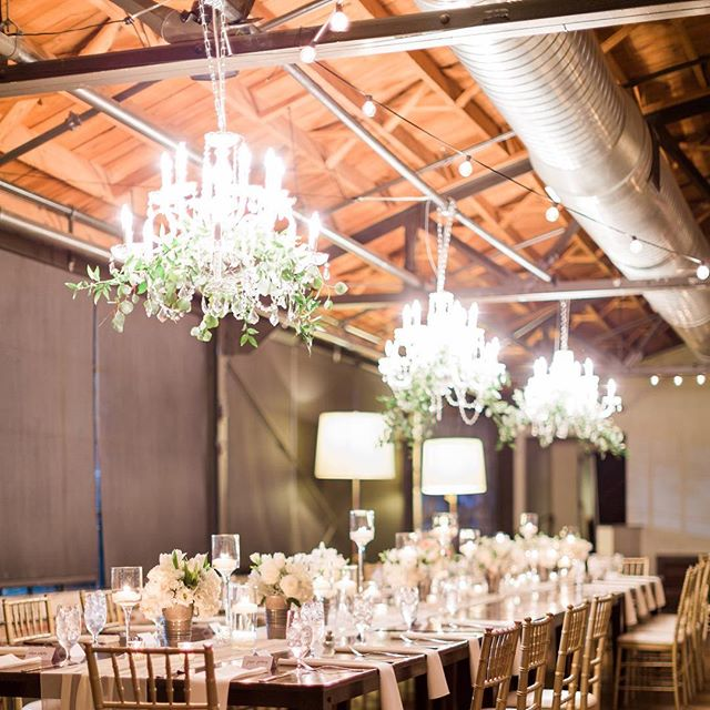 Our two tier crystal chandeliers on a dimmer providing just the right amount of light and style for this estate table at @summerourstudio #eventdecor #weddingdecor #crystal #chandeliers #estatetable #atlantaevents #cafelighting #uniqueeventelements