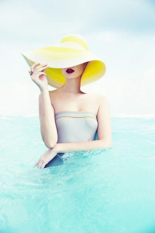 YELLOW HAT SUMMER GIRL OCEAN FASHION EDITORIAL