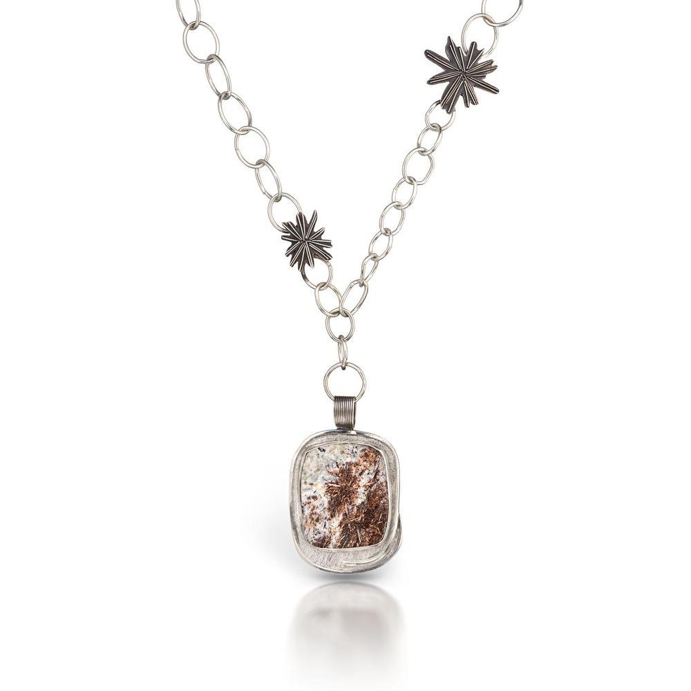 A strophyllite f  ireworks necklace
