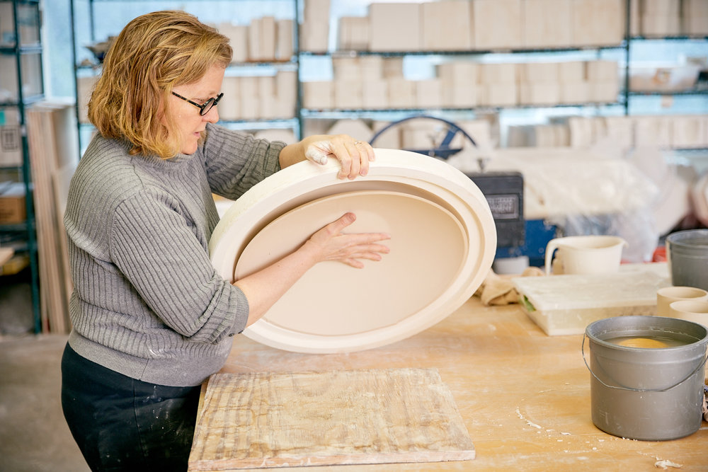 Unmolding a large low bowl.