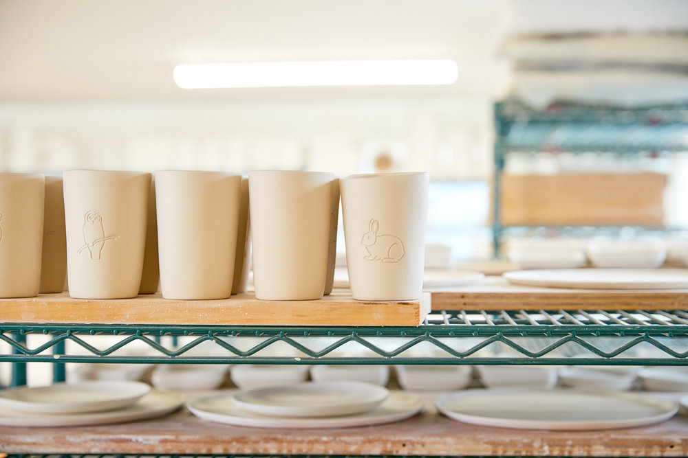 Tumblers and plates on the drying racks.