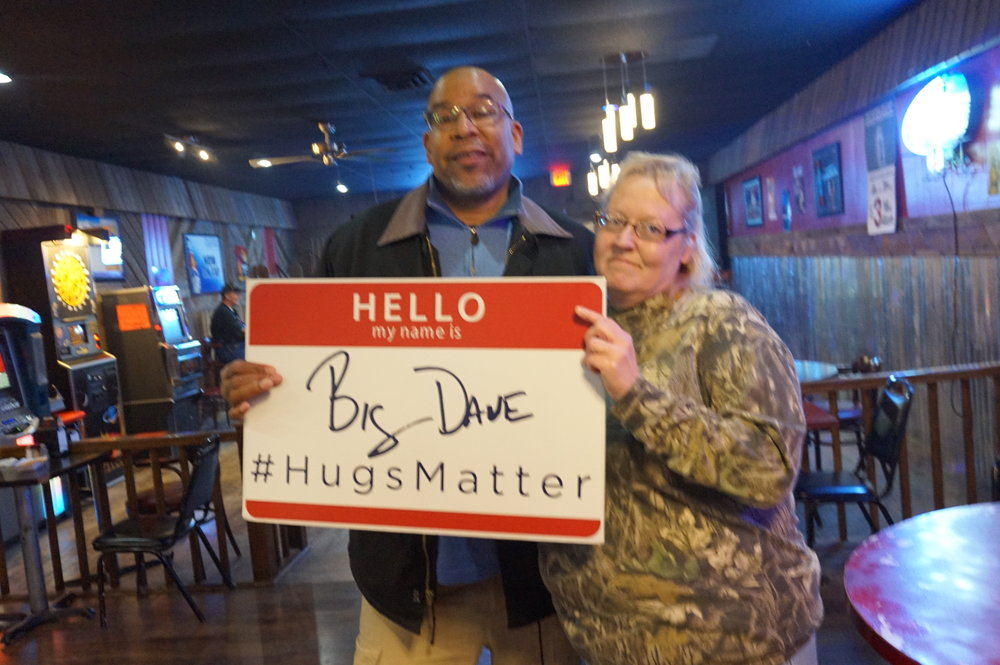 Nebraska  - When I held the Hug and High5 Party at the center of the nation in Lebanon, Kansas, I saw that I was just 19 miles from another state and figured that I would go there and hug some more people. Here I am with a woman from Red Cloud, Nebraska.