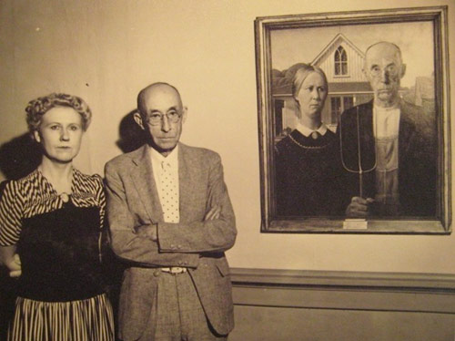 The models for American Gothic: do you think they're trying to mimic the serious faces in the painting? Something tells me they are. Look at the man's very subtle smile!