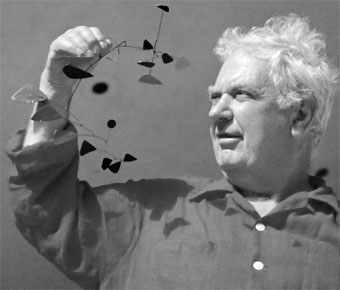 Alexander Calder (1898-1976 with one of his famous mobiles.