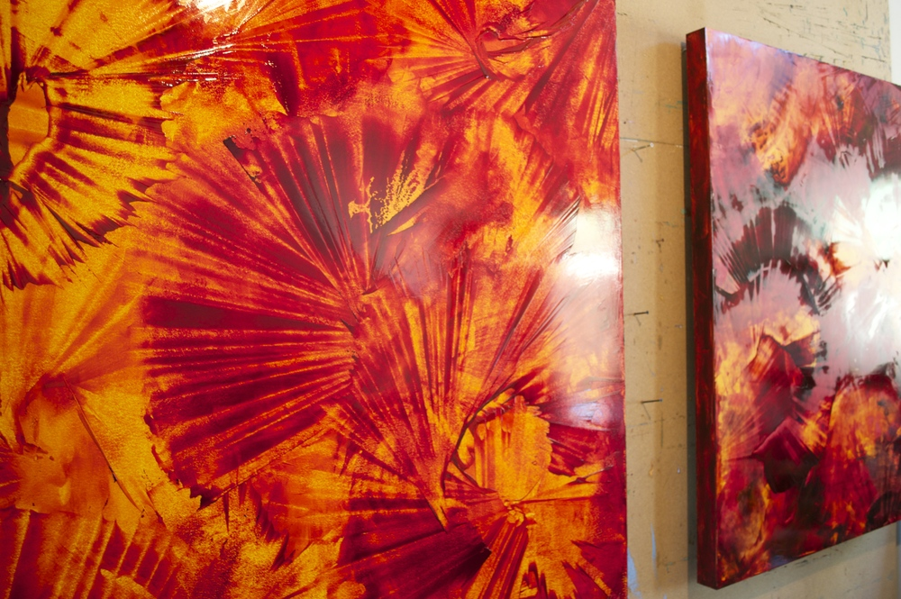 Like sun rays trapped on canvas, Mark's new orange and red paintings are fiery and super energetic.