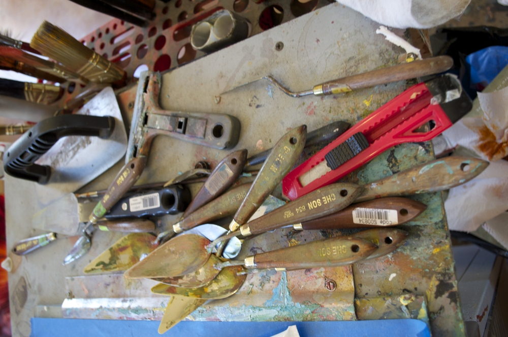 Mark uses squeeqees, sponges, trowels, and all kinds of tools to create his paintings.