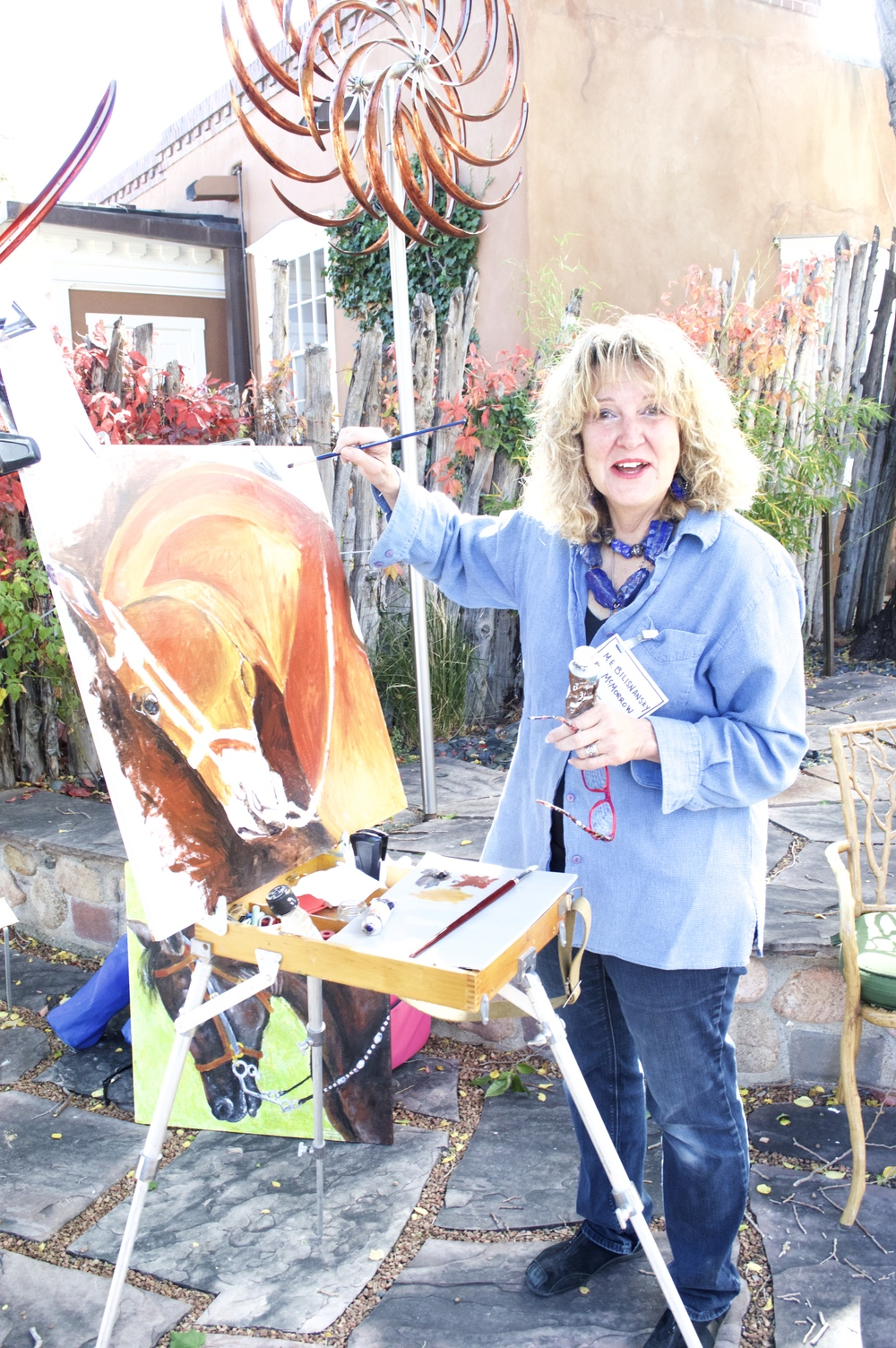 One of our visiting painters, working on a beautiful mahogany horse oil-on-canvas in our garden.