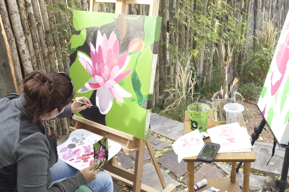 Local painter Natalie working on a water lily painting in our front garden.