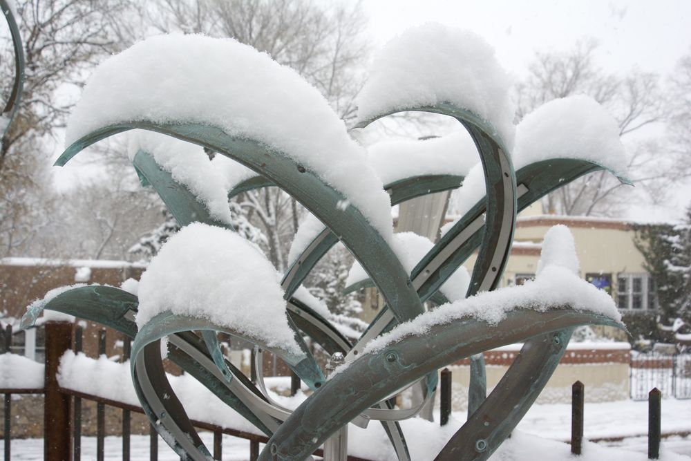 Here is Mark's lovely Counter-Revolving Iris sculpture in verdigris - with a generous covering of snow.