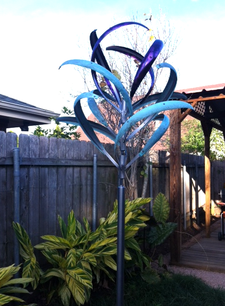 """Installed the Iris 3 Bud Top sculpture today and it's perfect in the side garden off my patio....Thanks to Mark for a lovely design and the colors are perfect!"" - Louise J., New Orleans, Louisiana"