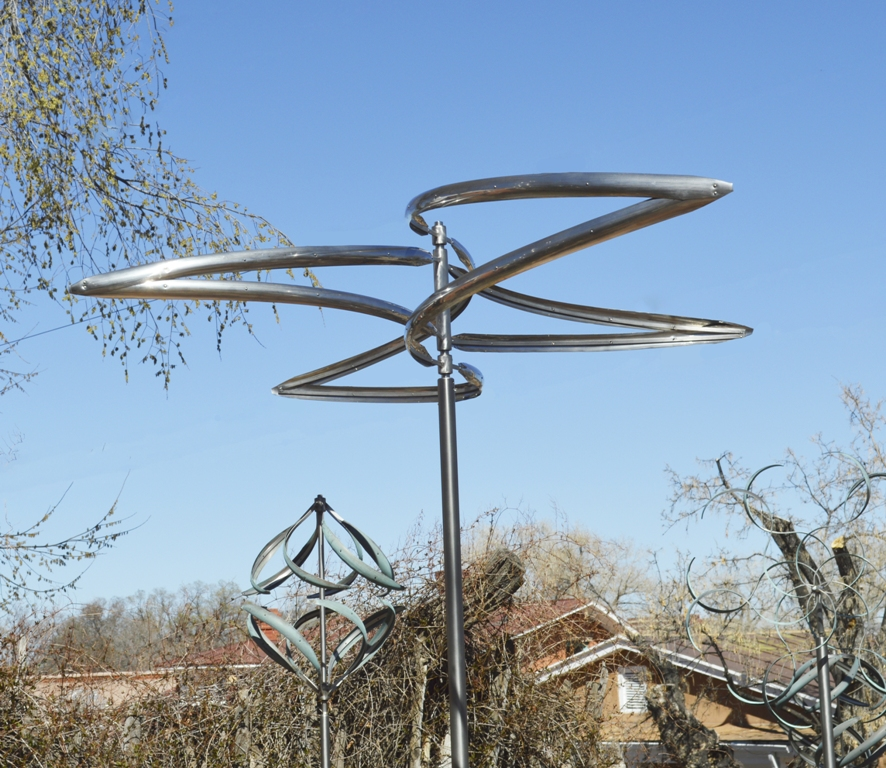 The sculpture's blades mimic the outstretched wings of a bird in flight.